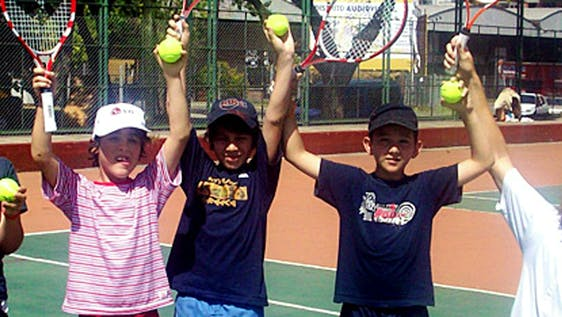 Teach Tennis to Local Children