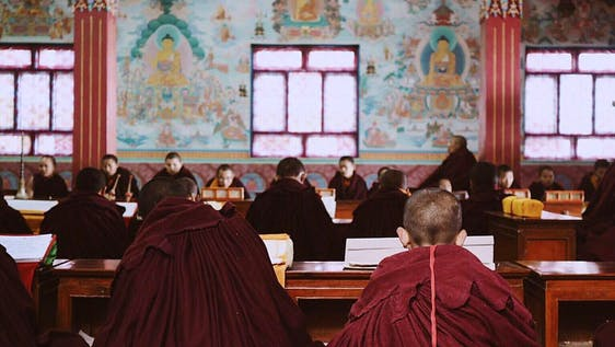 Teaching Buddhist Monks in Monastery